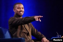 Actor Michael B. Jordan speaks with Oprah Winfrey on stage during a taping of her TV show in the Manhattan borough of New York City, New York, U.S., February 5, 2019. REUTERS/Carlo Allegri