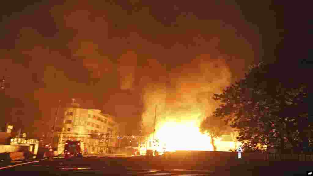 Flames from an explosion from an underground gas leak in the streets of Kaohsiung, Taiwan, Aug. 1, 2014.