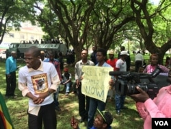 Police maintained a heavy presence at a Harare protest march but did not deter activists from accusing President Robert Mugabe's government of failing to respect human rights, March 9, 2016. (S. Mhofu/VOA)