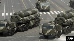 Columns of Russian S-400 Triumf launch vehicles, foreground, Pantsir S1 Air Defense Systems, center, and Iskander mobile ballistic missiles, background left, roll at the Moscow Red Square, Sunday, May 9, 2010, during the Victory Day Parade, which commemor