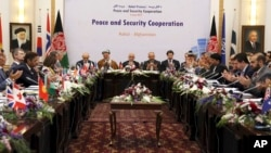 President Ashraf Ghani, center, is seen during the so-called Kabul Process conference at the Presidential Palace in Kabul, Afghanistan, June 6, 2017.