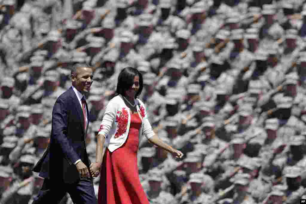 President Barack Obama and first lady Michelle are saluted by soldiers as they arrive at Fort Stewart in Georgia, April 27, 2012. (AP)