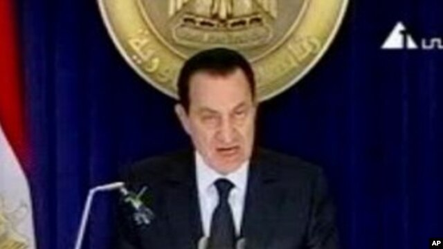 In this image made from video broadcast on Friday, Jan. 28, 2011, Egyptian President Hosni Mubarak appears on television, in his first appearance on television since protests erupted demanding his ouster