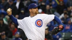Chicago Cubs starting pitcher Ryan Dempster delivers during the first inning of an opening day baseball against the Pittsburgh Pirates, Friday, April 1, 2011 in Chicago