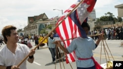 FILE PHOTO - Cambodian Student Society members Sraiph Phan, 21, left, and Danny Sre, 16, march during the Cambodian New Year's Parade in Long Beach Calif., on Sunday, April 24, 2005.
