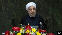 Iranian President Hassan Rouhani speaks during a debate in parliament on his proposed cabinet, in Tehran August 12, 2013.
