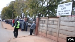 Voters queue to cast their ballots on July 31, 2013. ZEC says more than 300,000 voters across the country were turned away.