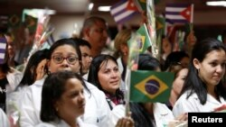 Cuban doctors take part in a welcoming ceremony at the Jose Marti International Airport after arriving from Brazil, in Havana, Cuba, Nov. 23, 2018.