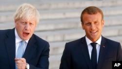 资料照片:英国首相约翰逊和法国总统马克龙上星期四(8-22-2019)。