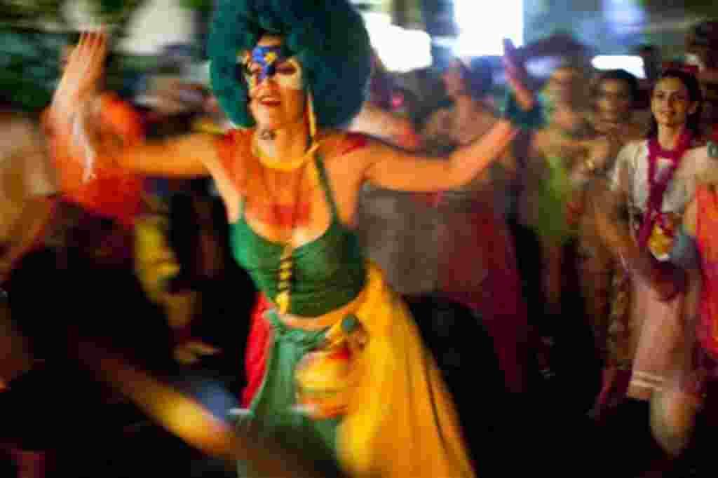 A reveler performs during the 'Mameludicos Euforicos' street carnival parade in Rio de Janeiro, Brazil, Thursday, March 3, 2011. (AP Photo/Rodrigo Abd)
