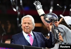 FILE - New England Patriots owner Robert Kraft raises the Vince Lombardi Trophy after winning Super Bowl LIII against the Los Angeles Rams at Mercedes-Benz Stadium in Atlanta, Georgia, U.S., Feb. 3, 2019.
