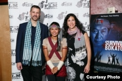 "From left to right: Mark Bochsler, Director; Tharoth ""Little Frog"" SAM, Cast Member; Sandra Leuba; Producer. (Courtesy Photo)"