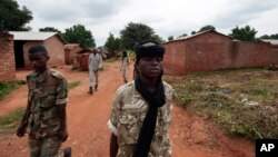 FILE - Seleka rebels walk through the town of Bria, Central African Republic, July 15, 2013. Recent fighting between rival militia groups, some in Bria, has killed 16 people, U.N. peacekeepers said Wednesday, Nov. 23, 2016.
