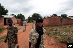 FILE - Seleka rebels walk through the town of Bria, Central African Republic, July 15, 2013. Recent fighting between rival militia groups in the Central African Republic has killed 16 people, U.N. peacekeepers said Wednesday, Nov. 23, 2016.
