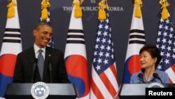 Барак Обама и Пак Кын Хе