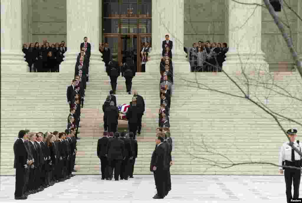 The casket containing the remains of the late U.S. Supreme Court Justice Antonin Scalia is carried up the steps of the Supreme Court after it arrived to lie in repose in the building's Great Hall in Washington D.C.