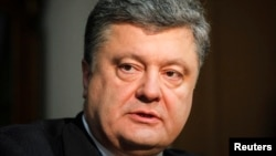 Petro Poroshenko, the billionaire owner of Ukrainian chocolate manufacture Roshen, and front-runner in Ukraine's presidential election, listens during an interview with Reuters in Kiev April 4, 2014