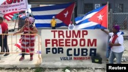 Ana Lacayo, (L) and Barbara Jimino, both of Miami, show their support for U.S. President Donald Trump near the Manuel Artime Theater in Miami, Florida, June 16, 2017.