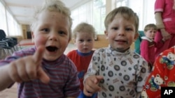 Kids look on in the Republican Hospital for Infectious Diseases, which specializes in treating HIV-positive children in Ust-Izhora outside St. Petersburg, Russia, May 30, 2006.