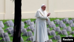 Pope Francis blesses the Austro-Hungarian cemetery at Fogliano in Redipuglia, Sept. 13, 2014.