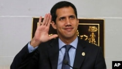Juan Guaido, President of National Assembly and self-proclaimed interim president waves to the gallery during a session of the National Assembly in Caracas, Venezuela, April 2, 2019.