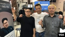 """""""Trump"""" and """"Kim"""" pose for photos with salon owner, Tuan Duong, in Hanoi, Vietnam, Feb. 19, 2019. (Photo - courtesy Tuan Duong)"""