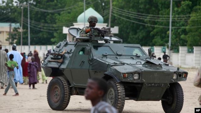 FILE - Nigerian army's armored vehicle in Maiduguri, Nigeria.