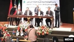 امضای قرارداد نفت و گاز بین ایران و توتال