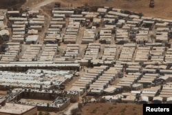 FILE - A general view shows tents of Syrian refugees on the outskirts of the Lebanese town of Arsal, near the border with Syria, Lebanon, Sept. 21, 2016.