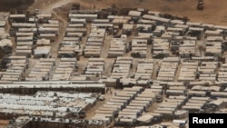 A general view shows tents of Syrian refugees on the outskirts of the Lebanese town of Arsal, near the border with Syria, Lebanon, Sept. 21, 2016. Syrian refugees account for 30 percent of Lebanon's population, the highest concentration per capita of refugees in the world.