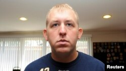 FILE - Darren Wilson, who resigned from the Ferguson Police Department, is pictured in an undated handout photo.