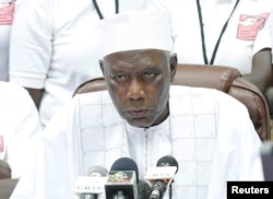 The president of Gambia's Independent Electoral Commission, Alieu Momarr Mjiar, announces presidential election results in Banjul, Gambia, Dec. 2, 2016.