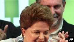 Brazil's President-elect Dilma Rousseff, of the Workers Party, gestures to supporters as she arrives to give her victory speech after winning the election runoff in Brasilia, Brazil, Sunday Oct. 31, 2010.