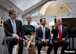 FILE - Donald Trump, right, along with his children, from left, Eric, Ivanka and Donald Jr. attend a ceremony announcing a new hotel and condominium complex in Vancouver, British Columbia June 19, 2013.