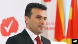 FILE - Zoran Zaev, leader of the opposition Social Democrats, presents the program of the new Macedonian government, at the party headquarters in Skopje, March 10, 2017.