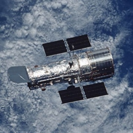 The Hubble Space Telescope, a large, space-based observatory, has revolutionized astronomy by providing unprecedented deep and clear views of the universe.