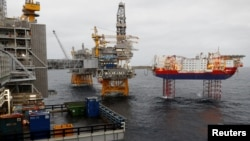 FILE PHOTO: Equinor's Johan Sverdrup oilfield platforms and accommodation jack-up rig Haven are pictured in the North Sea, Norway December 3, 2019. REUTERS/Ints Kalnins/File Photo