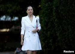 FILE - Huawei Technologies Chief Financial Officer Meng Wanzhou leaves her home to appear for a hearing in Vancouver, British Columbia, Canada, Sept. 30, 2019.