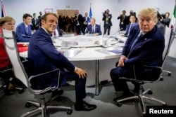 French President Emmanuel Macron and President Donald Trump participate in a G-7 Working Session on the Global Economy, Foreign Policy, and Security Affairs at the G-7 summit.