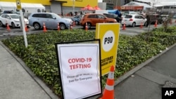 Cars line up at a pop-up community COVID-19 testing station at a supermarket carpark in Christchurch, New Zealand, Friday, April 17, 2020. New Zealand is into week four of a 28-day lockdown in a bid to stop the spread of the new coronavirus. (AP…
