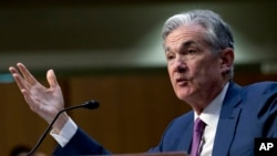 FILE - Federal Reserve Board Chair Jerome Powell testifies on Capitol Hill in Washington, July 17, 2018.