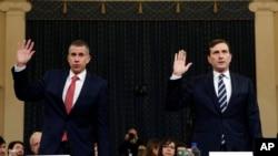 共和党律师卡斯特和民主党律师戈德曼在众议院司法委员会前宣誓作证。(2019年12月9日)