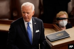 President Joe Biden turns from the podium after speaking to a joint session of Congress, April 28, 2021, in the House Chamber at the U.S. Capitol in Washington.