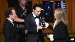 """Barbra Streisand, right, presents the award for best musical to Lin-Manuel Miranda, center, of """"Hamilton,"""" as producer Jeffrey Seller looks on at the Tony Awards at the Beacon Theatre on Sunday, June 12, 2016."""