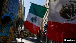 FILE - Mexican flags are displayed at a Hispanic Day Parade in New York.