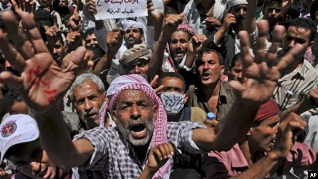 An anti-government protester reacts during a demonstration demanding the resignation of Yemeni President Ali Abdullah Saleh in Taiz, Yemen, April 17, 2011