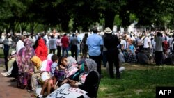People gather in Lafayette Park, outside the White House in Washington, to protest against the deadly military raid on a nonviolent sit-in in Khartoum, Sudan, June 8, 2019.
