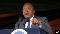FILE - Kenyan President Uhuru Kenyatta speaks during Jamhuri Day celebrations (Independence Day) at Nyayo Stadium in Nairobi, Dec. 12, 2016. Kenyatta says his Jubilee Party will hold new primary voting April 24-25, 2017.