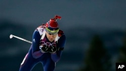 Norway's Ole Einar Bjoerndalen competes on his way to win gold in the men's biathlon 10k sprint, 2014 Winter Olympics, Sochi,Feb. 8, 2014.