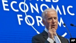 US Vice President Joe Biden gestures as he speaks at the plenary session of the World Economic Forum in Davos, Switzerland, Jan. 20, 2016.